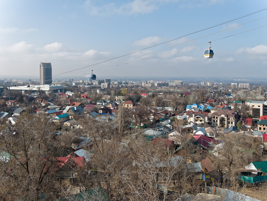 Cable car with Almaty and the Kazakhstan Hotel in the background.